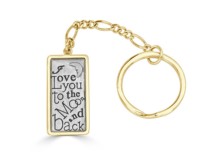 Key chain in 14k yellow gold and sterling silver.