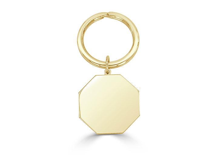 Key chain in 14k yellow gold.