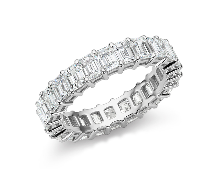 Emerald cut diamond eternity band in platinum.