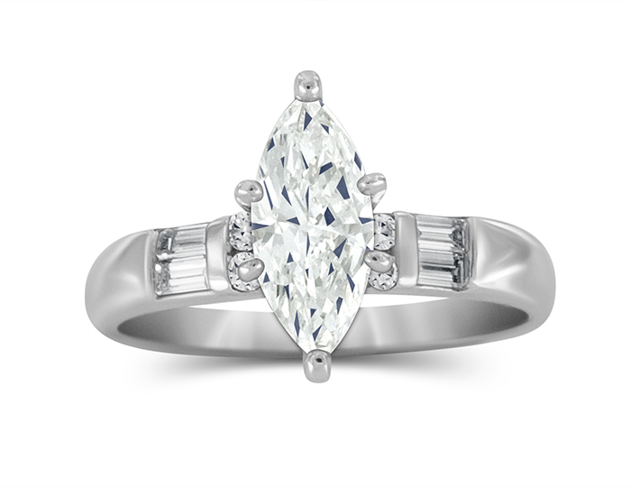 Marquise cut center diamond and round brilliant cut and baguette cut diamond engagement ring in platinum.