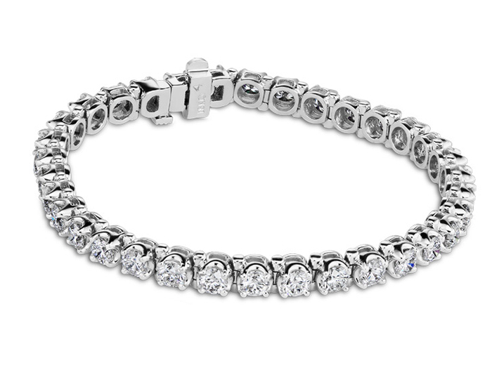 Round brilliant cut diamond tennis bracelet in 18k white gold.                                              In stock from $3,450 to $22,700.