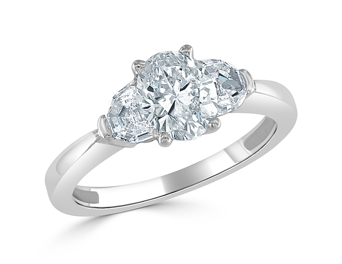 Oval and half-moon shape diamond three-stone engagement ring in platinum.