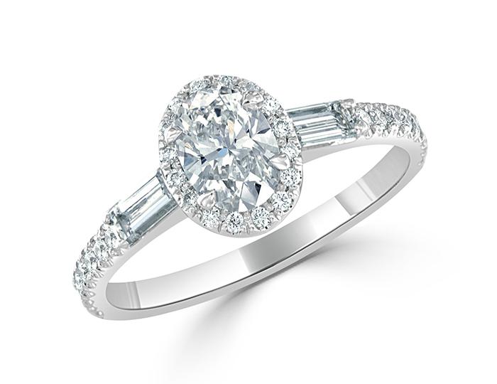 Bez Ambar oval, baguette and round brilliant cut diamond ring in platinum.