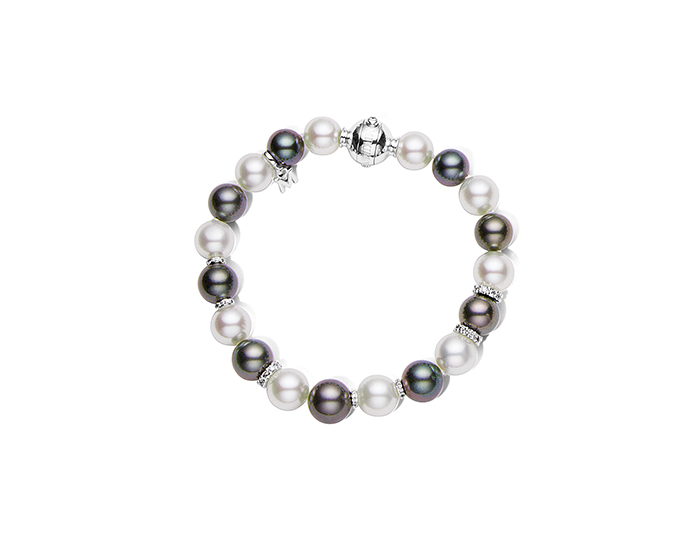 Mikimoto 9.5x8.4mm black and white South Sea pearl bracelet with round brilliant cut diamond rondelles and an 18k white gold clasp.