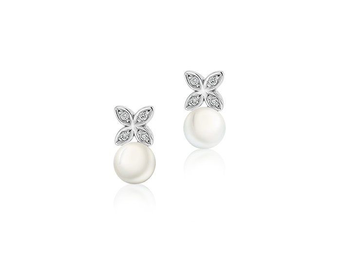 Mikimoto cultured pearl and round brilliant cut diamond earrings in 18k white gold.