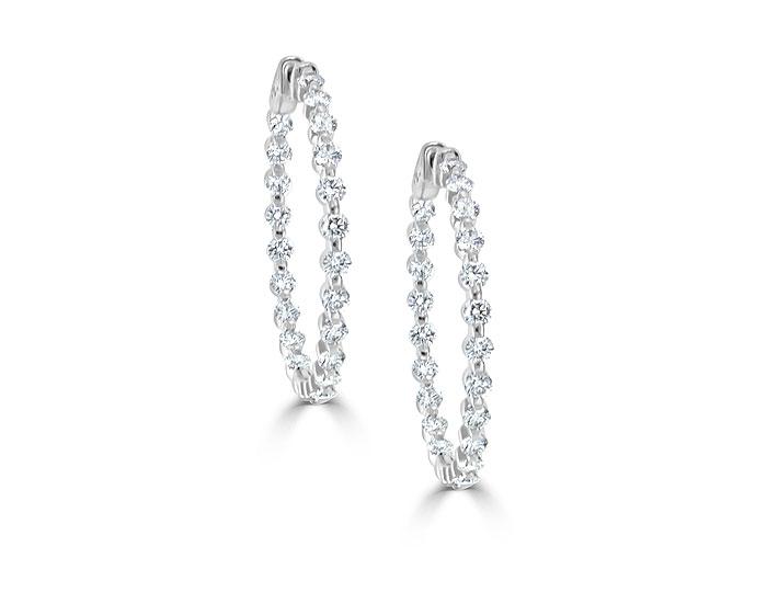 Round brilliant cut diamond hoop earrings in 18k white gold.