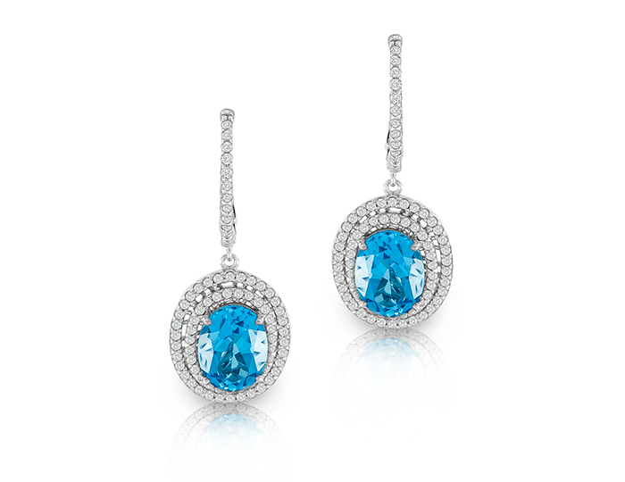 Blue topaz and round brilliant cut diamond earrings in 18k white gold.