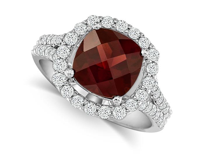 Garnet and round brilliant cut diamond ring in 18k white gold.