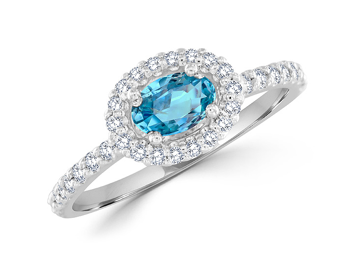 Oval shape aquamarine and round brilliant cut diamond ring in 18k white gold.