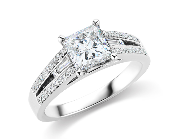 Princess cut diamond engagement ring with blaze, baguette and round brilliant cut diamonds in platinum.