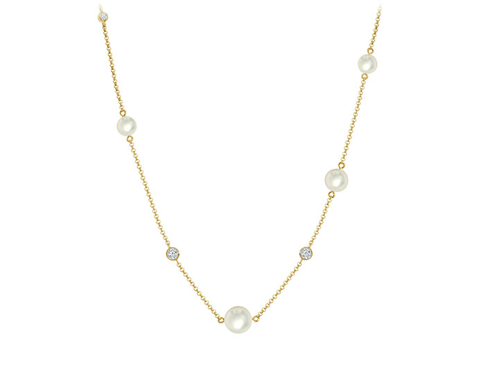"Mikimoto akoya pearl and round brilliant cut diamond 31"" station necklace in 18k yellow gold."