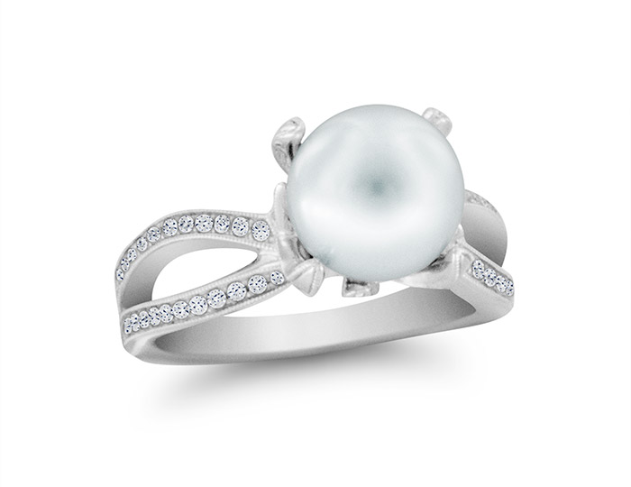 Mikimoto pearl and round brilliant cut diamond ring in 18k white gold.