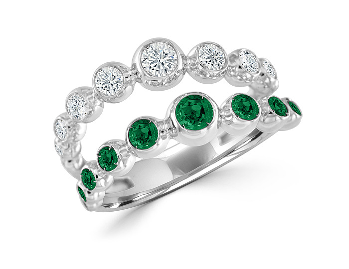 Casato emerald and round brilliant cut diamond ring in 18k white gold.