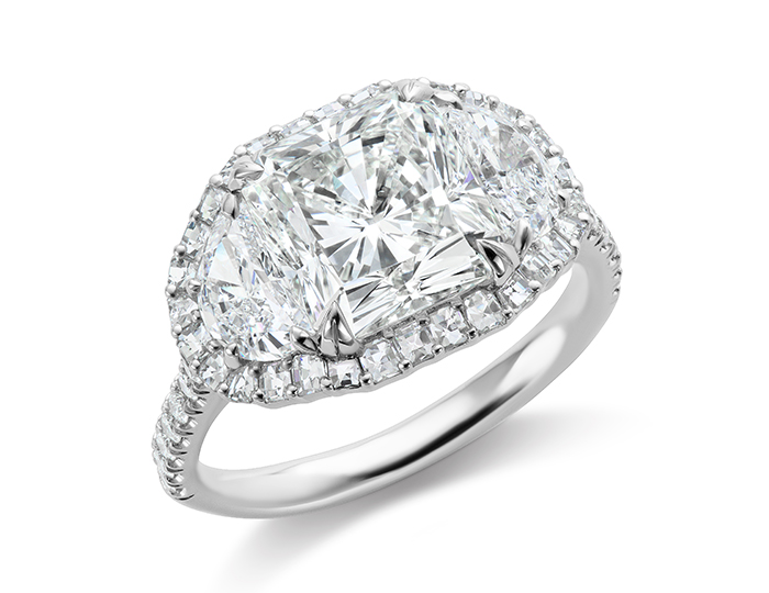 Radiant cut, half moon shape, blaze cut and round brilliant cut diamond engagement ring in platinum.