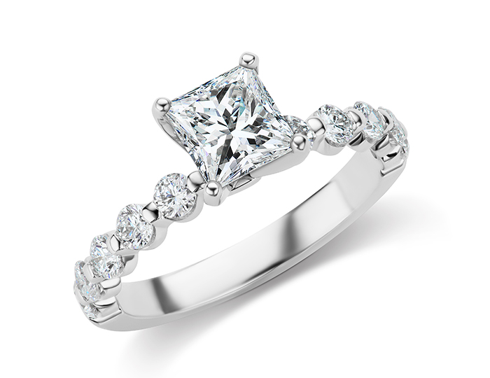 Princess cut and round brilliant cut diamond engagement ring in 14k white gold.