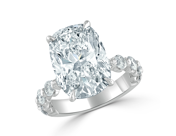 Cushion and round brilliant cut diamond ring in platinum.