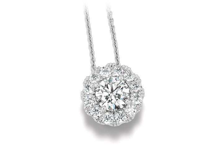 Round brilliant cut diamond halo pendant in 18k white gold.                                                In stock from $1,150 to $15,500.