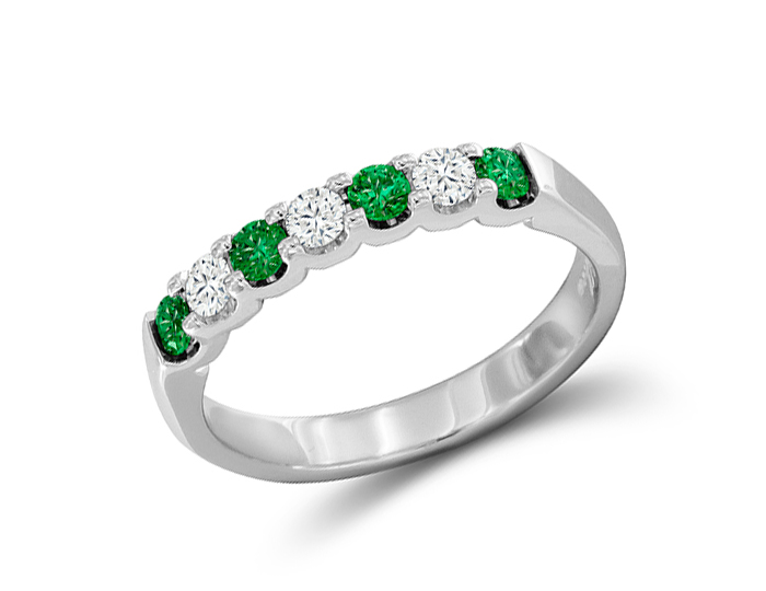 Emerald and round brilliant cut diamond band in 18k white gold.