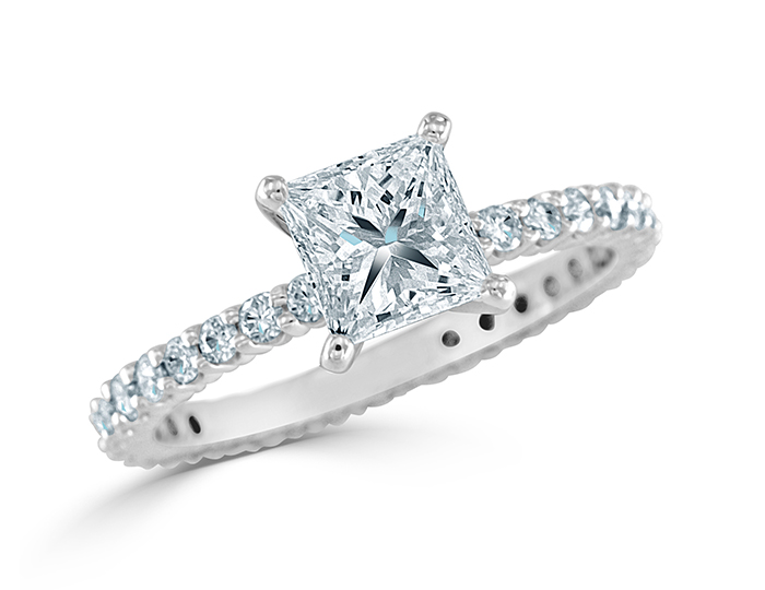 Princess cut and round brilliant cut diamond engagement ring in 18k white gold.