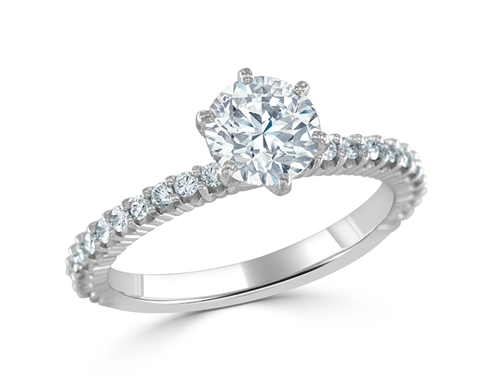 Round brilliant cut diamond engagement ring in 18k white gold.
