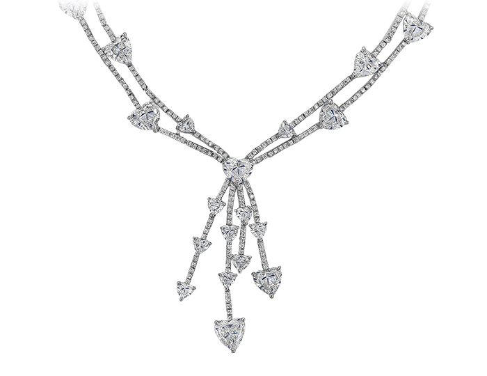Heart shape and round brilliant cut diamond necklace in platinum.