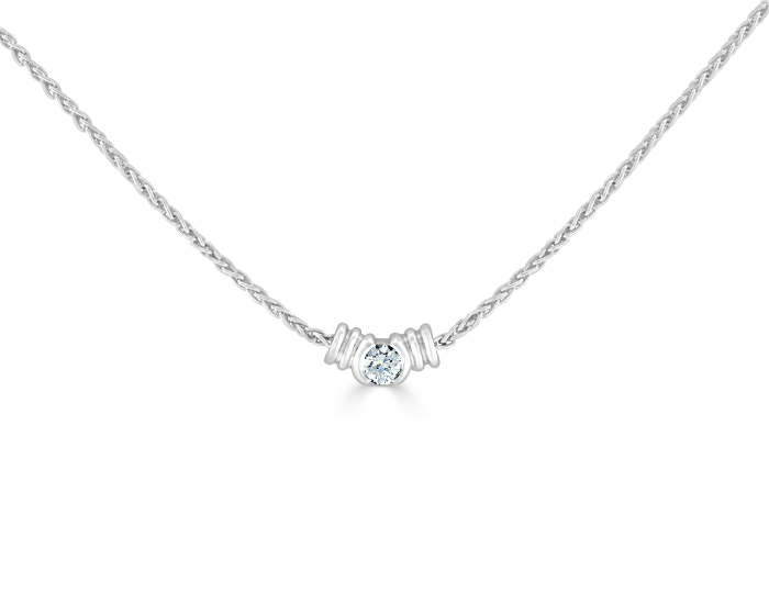 Round brilliant cut diamond solitaire pendant in platinum.
