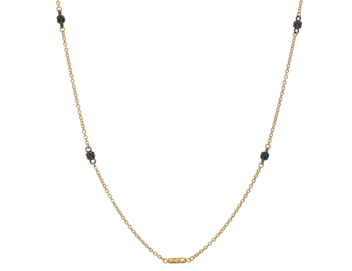 Gurhan round brillant cut black diamond necklace in 22k yellow gold.