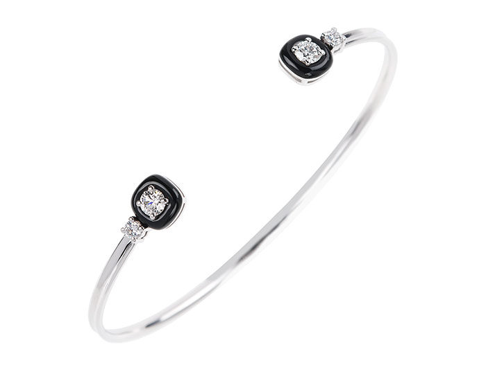 Nikos Koulis Oui collection diamond and black enamel bracelet in 18k white gold.