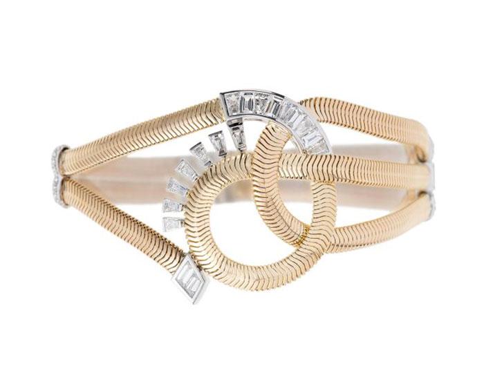 Nikos Koulis Feelings collection baguette cut diamond bracelet in 18k yellow and white gold.
