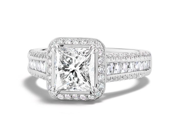 Princess cut, blaze cut and round brilliant cut diamond engagement ring in platinum.