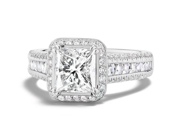 Princess cut, blaze cut and round brilliant cut diamond engagement ring in platinum.