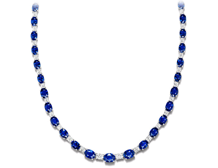 Oval shape sapphire and oval shape diamond necklace in 18k white gold.