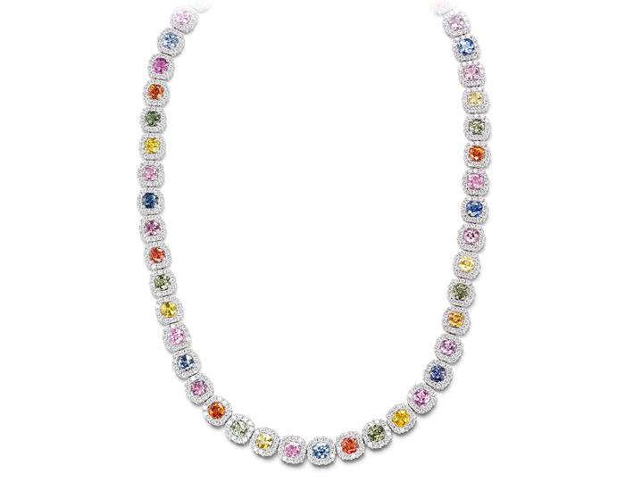 Cushion shape fancy colored sapphire and round brilliant cut diamond necklace in 18k white gold.