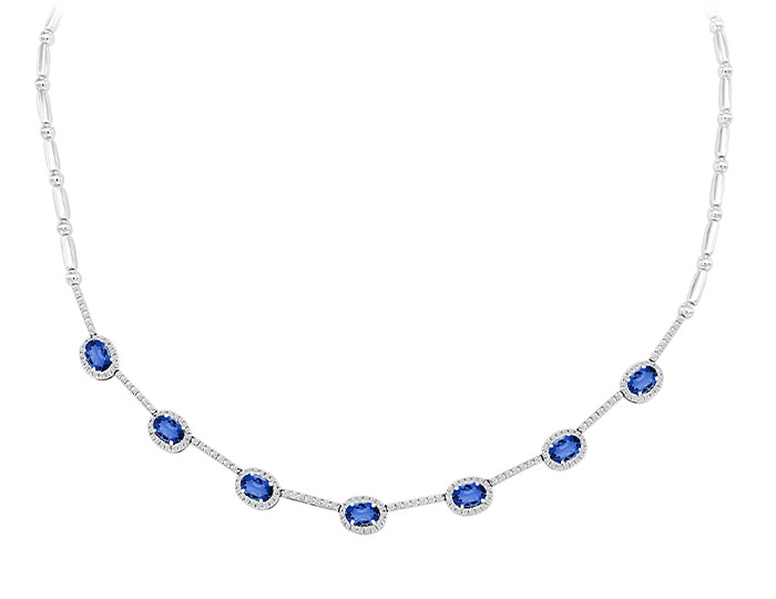 Oval shape sapphire and round brilliant cut diamond necklace in 18k white gold.
