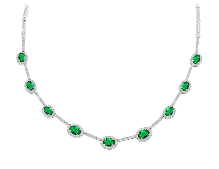 Oval shape emerald and round brilliant cut diamond necklace in 18k white gold.