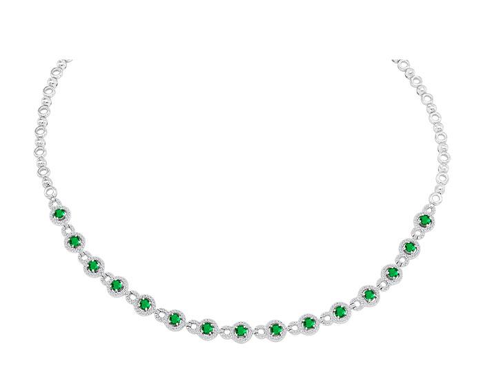 Emerald and round brilliant cut diamond necklace in 18k white gold.