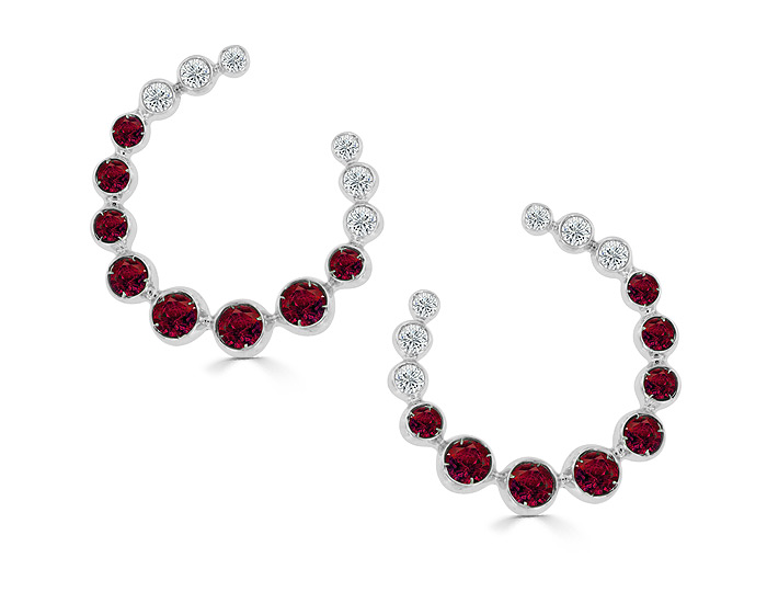 Casato ruby and round brilliant cut diamond earrings in 18k white gold.