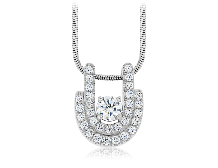 Round brilliant cut diamond pendant in platinum.