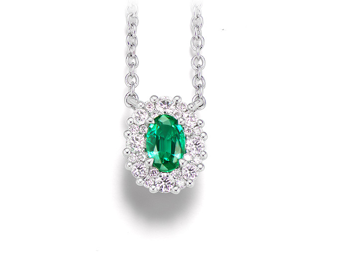 Oval shape emerald and round brilliant cut diamond pendant in 18k white gold.