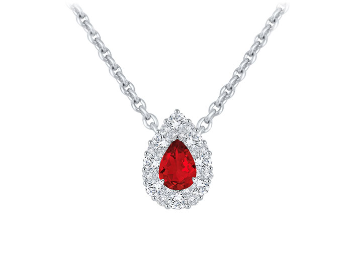 Pear shape ruby and round brilliant cut diamond pendant in 18k white gold.