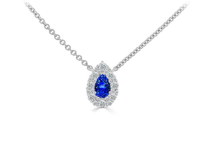 Pear shape sapphire and round brilliant cut diamond pendant in 18k white gold.