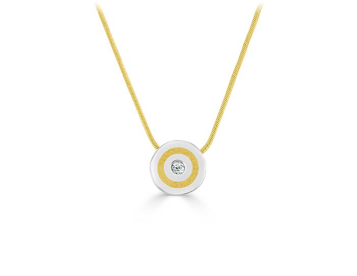 Round brilliant cut diamond pendant in 18k yellow gold and platinum.