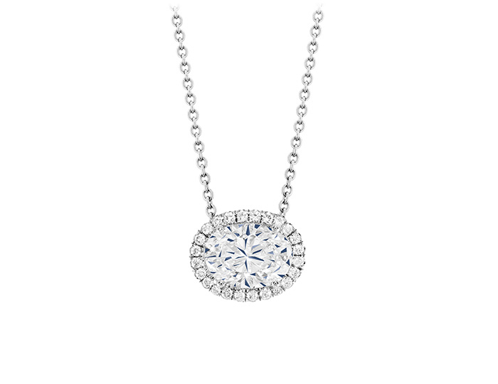Oval and round brilliant cut diamond pendant in 18k white gold.