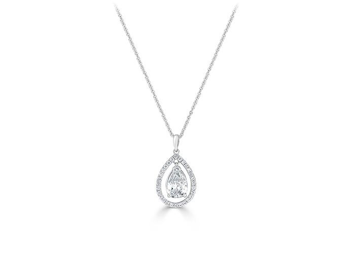 Pear and round brilliant cut diamond pendant in 18k white gold.