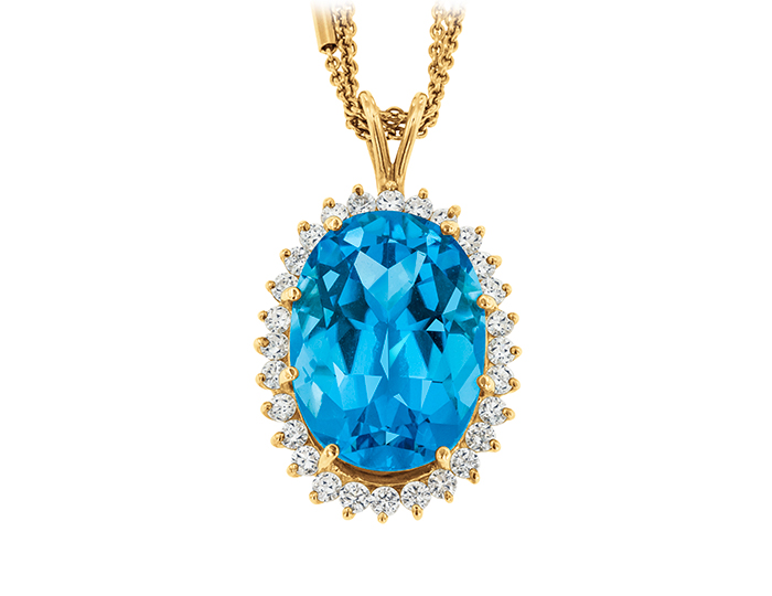 Blue topaz and round brilliant cut diamond pendant in 18k yellow gold.
