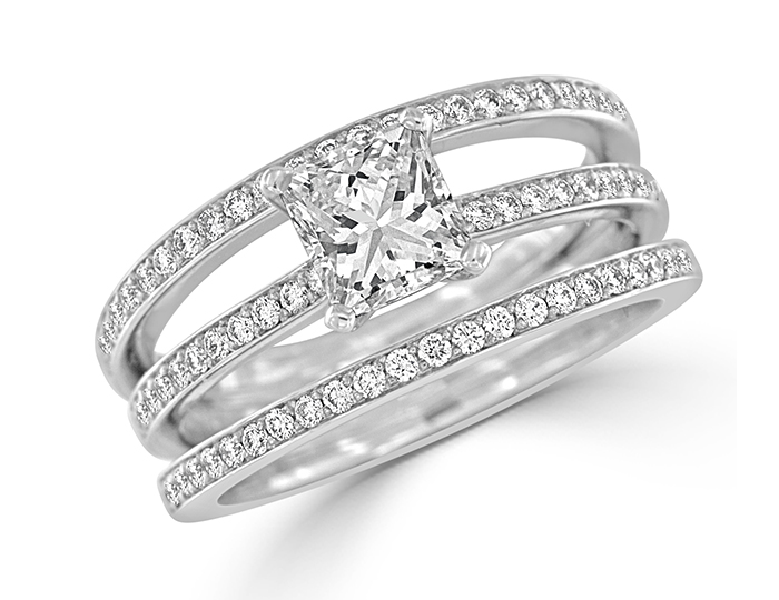 Bez Ambar princess and round brilliant cut diamond ring in 18k white gold.