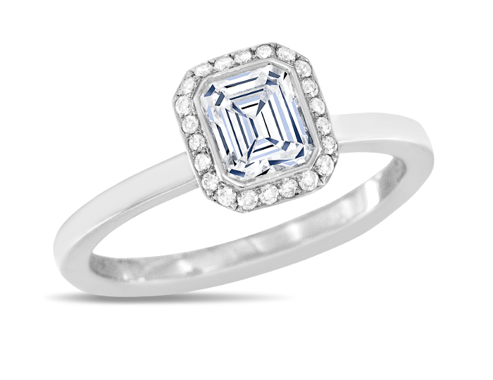 Emerald cut center diamond with round brilliant cut diamond engagement ring in 18k white gold.