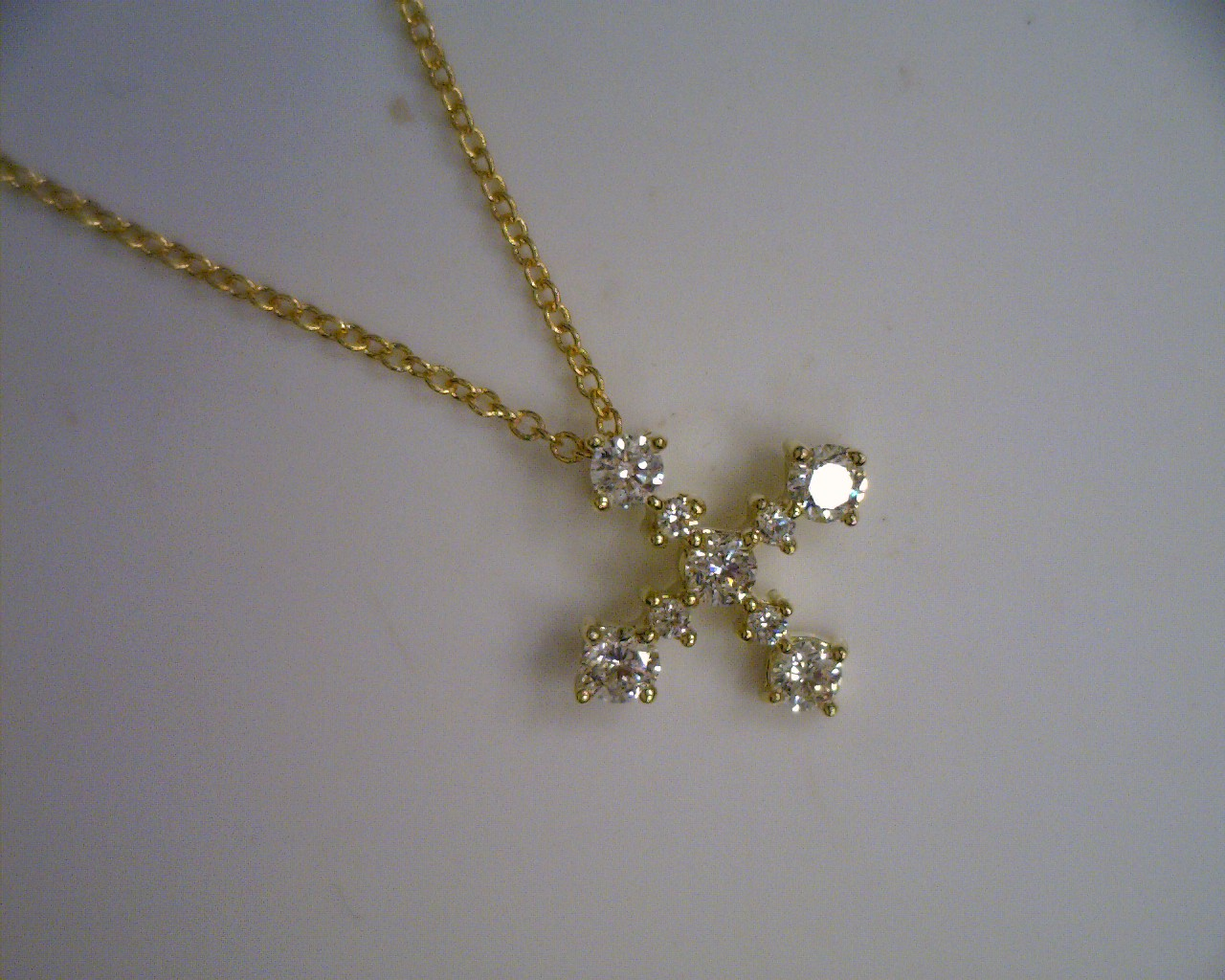 Maria Canale Essentials Collection round brilliant cut and rose cut diamond cross in 18k white gold.