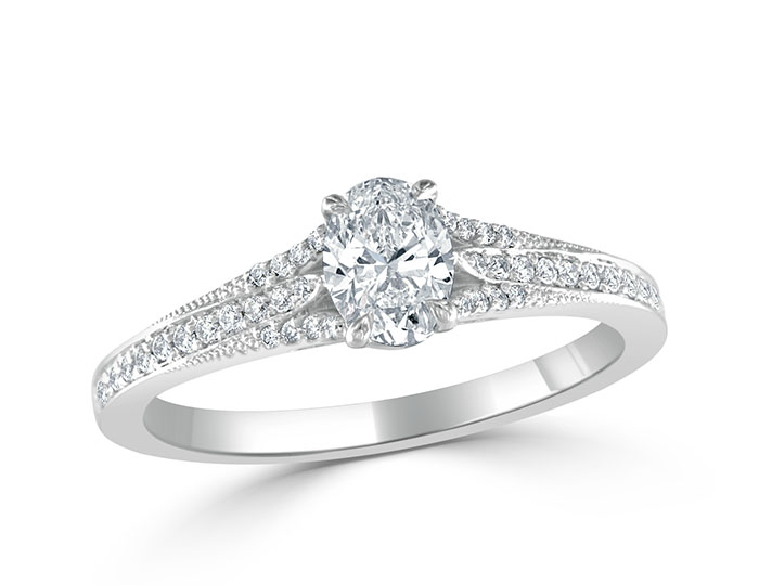 Ladies oval and round brilliant cut diamond engagement ring in platinum.