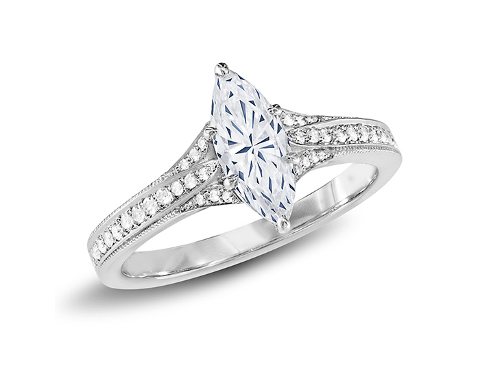 Marquise and round brilliant cut diamond engagement ring in platinum.